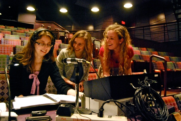 Stage manager Christina Henricks '13, Bumke, and spotlight operator Laura Gates '14 share a laugh during a break in rehearsal. Sunday in the Park with George is a thesis project for Bumke, Linneman, and Wilson.